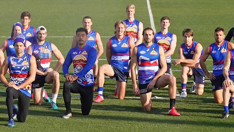 Seen here, Western Bulldogs layers kneel at training in support of the BLM movement.