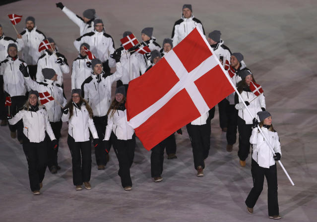 <p>Elena Moller Rigas carries the flag of Denmark during the opening ceremony of the 2018 Winter Olympics in Pyeongchang, South Korea, Friday, Feb. 9, 2018. (AP Photo/Michael Sohn) </p>