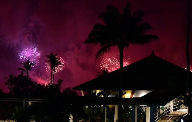 <p>Fireworks light the night sky over Abidjan during New Year celebrations on January 1, 2018. (Photo: Issouf Sanogo/AFP/Getty Images) </p>