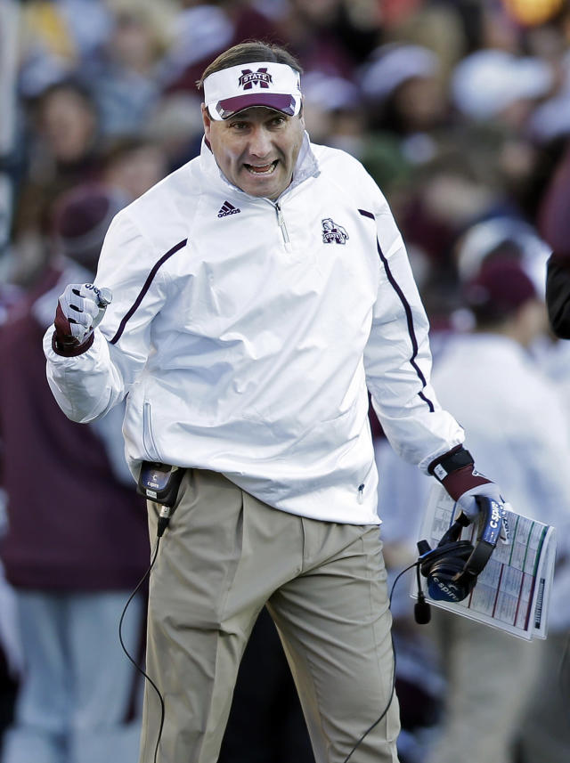 Mississippi State head coach Dan Mullen congratulates players after a score against Rice in the first quarter of the Liberty Bowl NCAA college football game on Tuesday, Dec. 31, 2013, in Memphis, Tenn. (AP Photo/Mark Humphrey)