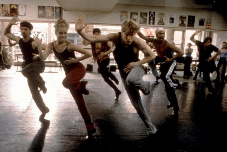 <p>If you haven't seen <strong>Center Stage</strong>, which came out in 2000, I highly recommend it. While the ballet company danced freestyle in their sweats, I'll never forget Amanda Schull, who plays Jody, rocking these red sweats in particular, worn over a bodysuit with her jazz shoes.</p>