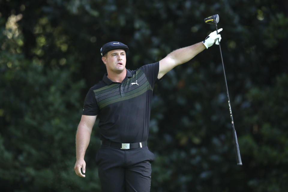 Bryson DeChambeau reacts to his tee shot on the 11th hole during the first round of the Masters golf tournament Thursday, Nov. 12, 2020, in Augusta, Ga. (Curtis Compton/Atlanta Journal-Constitution via AP)