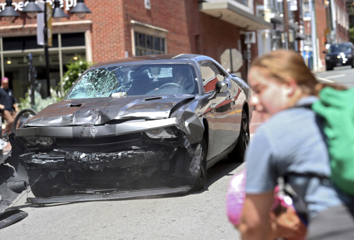 <p>A vehicle reverses after driving into a group of protesters demonstrating against a white nationalist rally in Charlottesville, Va., Saturday, Aug. 12, 2017. (Photo: Ryan M. Kelly/The Daily Progress via AP) </p>