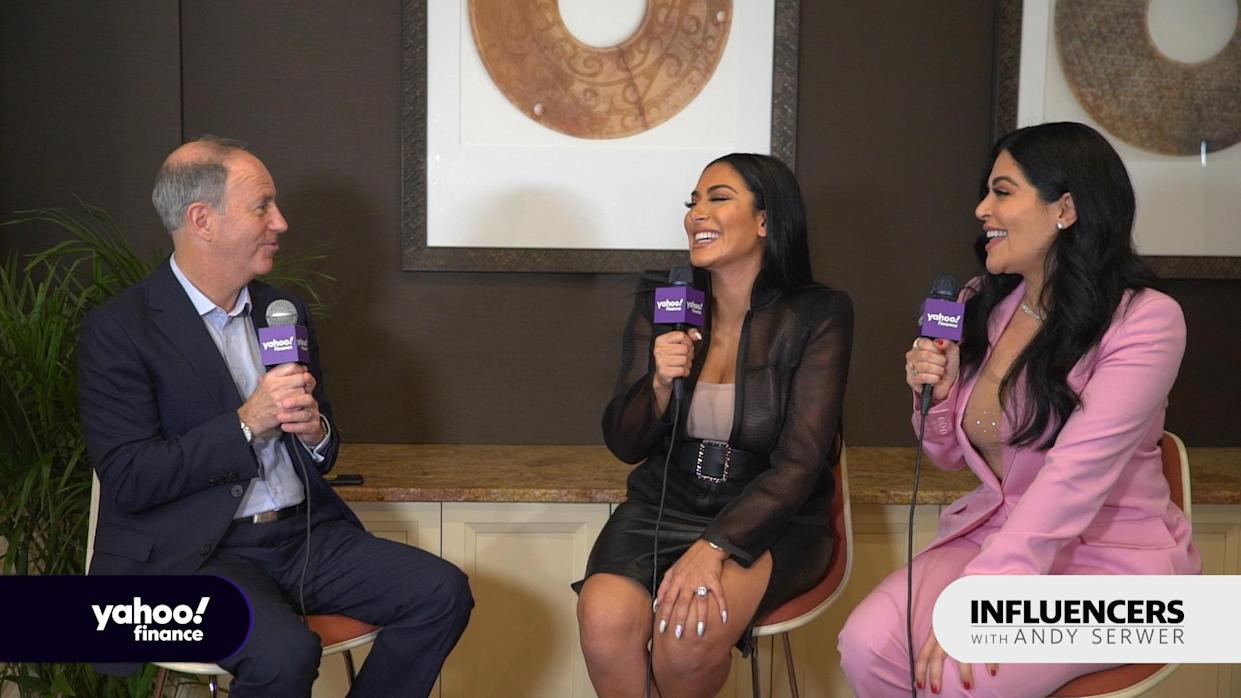 Beauty influencer Huda Kattan (left) appears on Influencers with Andy Serwer alongside her sister and business partner Mona Kattan (right).