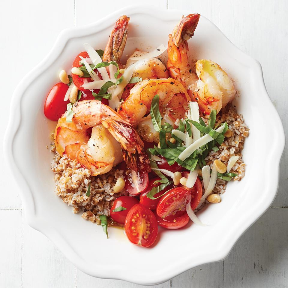 "<p>Topped with Parmesan cheese, pine nuts, and fresh basil, this savory dish is sure to leave you satisfied. <a href=""http://www.eatingwell.com/recipe/264407/shrimp-bulgur-and-tomato-bowls/"" rel=""nofollow noopener"" target=""_blank"" data-ylk=""slk:View recipe"" class=""link rapid-noclick-resp""> View recipe </a></p>"