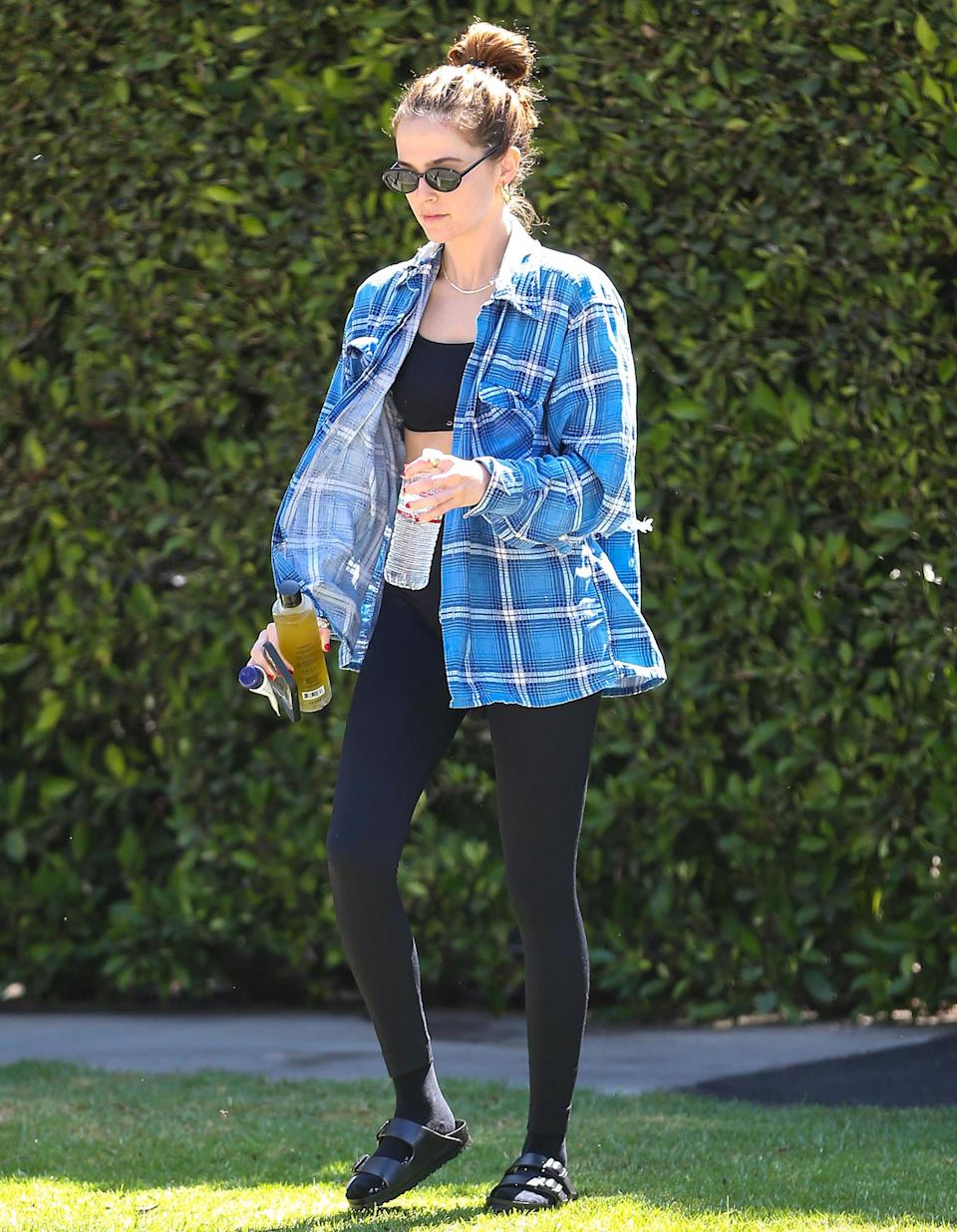 <p>Zoey Deutch steps out in L.A. in a flannel and leggings on July 2.</p>