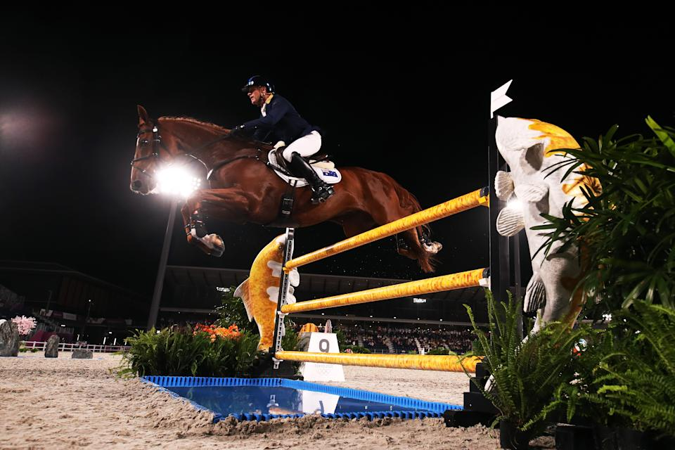 <p>TOKYO, JAPAN - AUGUST 02: Andrew Hoy of Team Australia riding Vassily de Lassos competes during the Eventing Individual Jumping Final on day ten of the Tokyo 2020 Olympic Gamesat Equestrian Park on August 02, 2021 in Tokyo, Japan. (Photo by Julian Finney/Getty Images)</p>