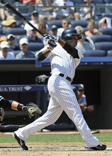 New York Yankees' Dewayne Wise hits a home run during the fifth inning of a baseball game against the Chicago White Sox Saturday, June 30, 2012, at Yankee Stadium in New York. (AP Photo/Bill Kostroun)