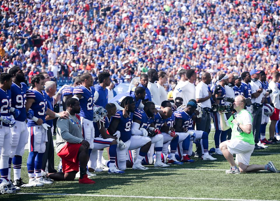 Buffalo Bills players kneel during the American National anthem before an NFL game against the Denver Broncos on September 24, 2017 at New Era Field in Orchard Park, New York. (Photo by Brett Carlsen/Getty Images)