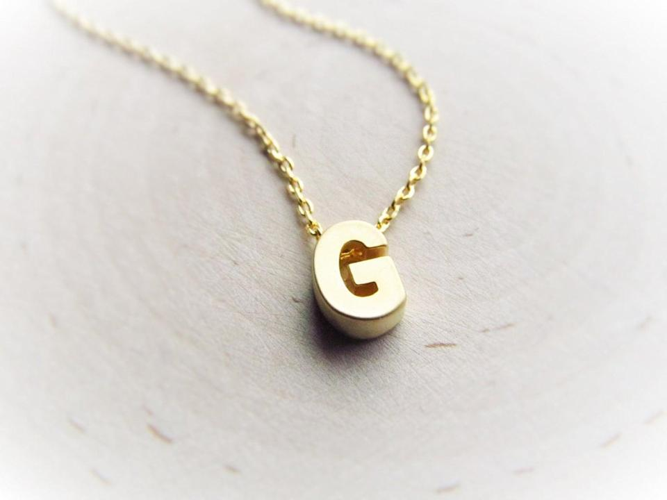 <p>Make it personal, and give them this <span>Gold Initial Necklace</span> ($21).</p>