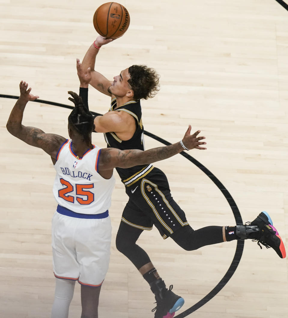 Atlanta Hawks' Trae Young (11) shoots and is fouled by New York Knicks' Reggie Bullock (25) during the first half in Game 4 of an NBA basketball first-round playoff series Sunday, May 30, 2021, in Atlanta. (AP Photo/Brynn Anderson)