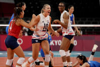 United States' Justine Wong-Orantes, from left, United States' Jordan Larson and United States' Foluke Akinradewo celebrate winning a point during the women's volleyball preliminary round pool B match between China and United States at the 2020 Summer Olympics, Tuesday, July 27, 2021, in Tokyo, Japan. (AP Photo/Frank Augstein)