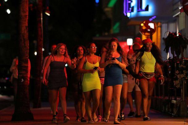 PHOTO: University students walk along a street of Miami Beach during Spring Break after local authorities closed restaurants, bars, gyms, movie theaters and other similar businessesdue to coronavirus disease in Miami Beach, Florida, U.S., March 18, 2020. (Carlos Barria/Reuters)