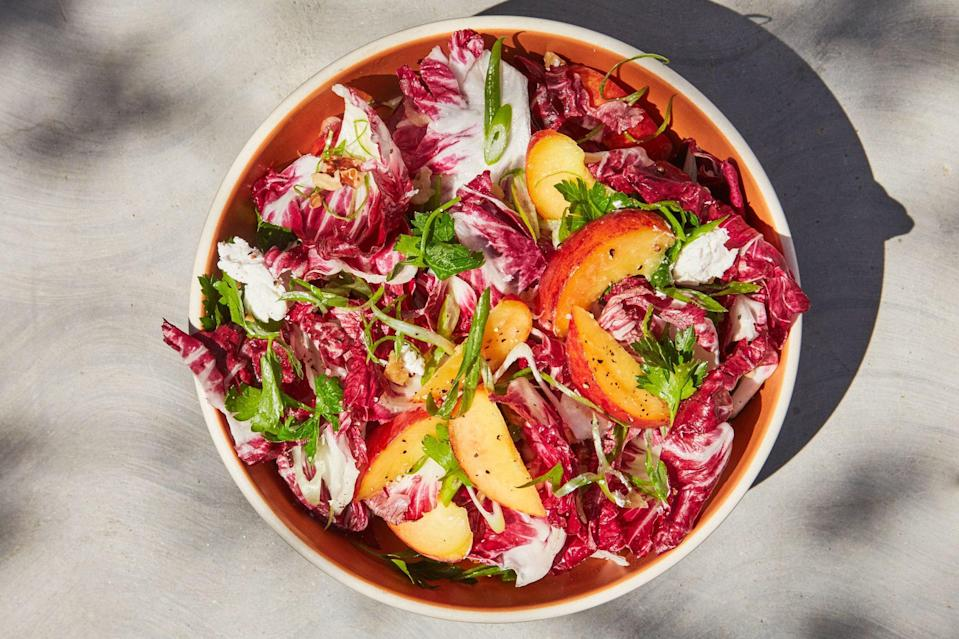 """With a complex mixture of flavors—toasty walnuts, bitter veg, and sweet juicy fruit, brought together with a light, lemony dressing—this sophisticated summer salad can be made with whatever stone fruits suit your fancy: Peaches, nectarines, and apricots all work well. <a href=""""https://www.epicurious.com/recipes/food/views/radicchio-stone-fruit-salad?mbid=synd_yahoo_rss"""" rel=""""nofollow noopener"""" target=""""_blank"""" data-ylk=""""slk:See recipe."""" class=""""link rapid-noclick-resp"""">See recipe.</a>"""