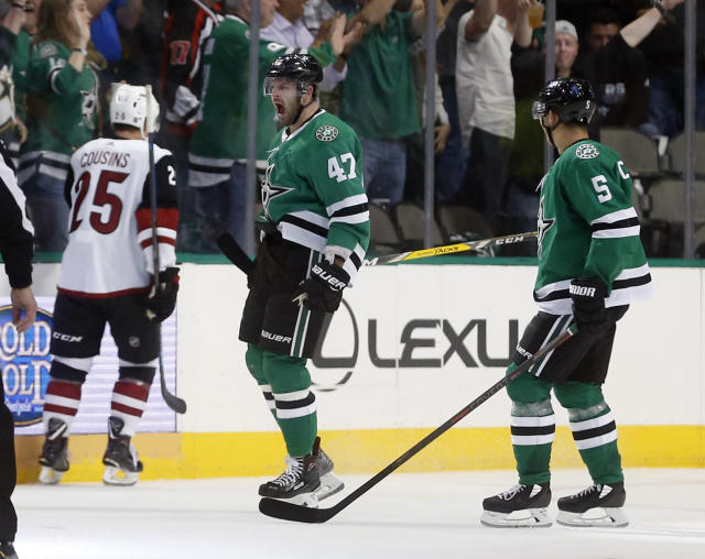 Dallas Stars right wing Alexander Radulov (47) celebrates his goal with defenseman Connor Carrick (5) as Arizona Coyotes center Nick Cousins (25) skates away during the second period of an NHL hockey game in Dallas, Thursday, Oct. 4, 2018. (AP Photo/Michael Ainsworth)