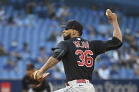 Cleveland Indians' J. C. Mejia pitches against the Toronto Blue Jays during the first inning of a baseball game Wednesday, Aug. 4, 2021, in Toronto. (Jon Blacker/The Canadian Press via AP)