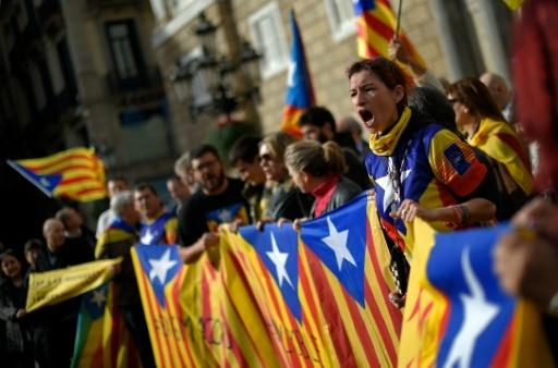 After bitter in-fighting, Catalan separatists to form government