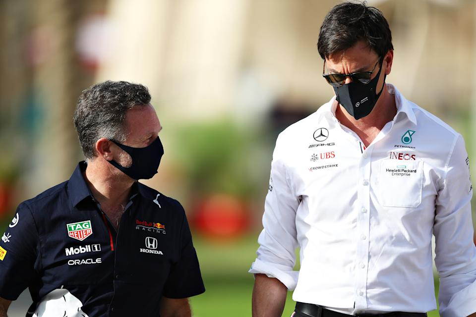 BAHRAIN, BAHRAIN - MARCH 26: Red Bull Racing Team Principal Christian Horner and Mercedes GP Executive Director Toto Wolff talk in the Paddock during practice ahead of the F1 Grand Prix of Bahrain at Bahrain International Circuit on March 26, 2021 in Bahrain, Bahrain. (Photo by Mark Thompson/Getty Images)