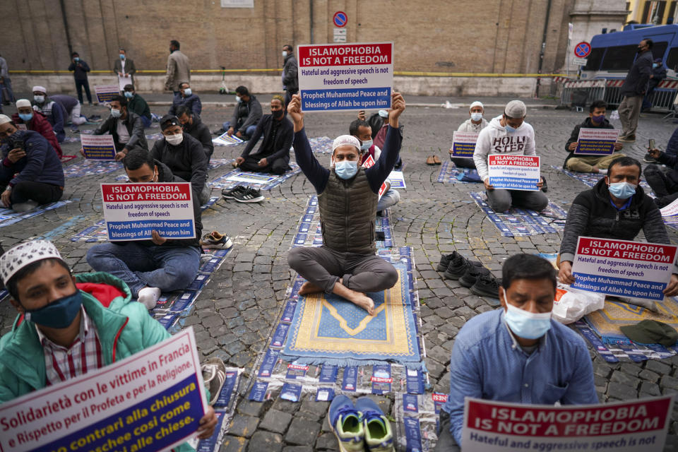 Members of an Italian Muslim association stage a sit-in and prayer to condemn what they see as persecutory acts against the Islamic community in France and against the publication of pictures and what they see as disrespect of the Prophet Muhammad, in Rome, Friday, Oct. 30, 2020. The protesters also condemned the attack in Nice, France. (AP Photo/Andrew Medichini)