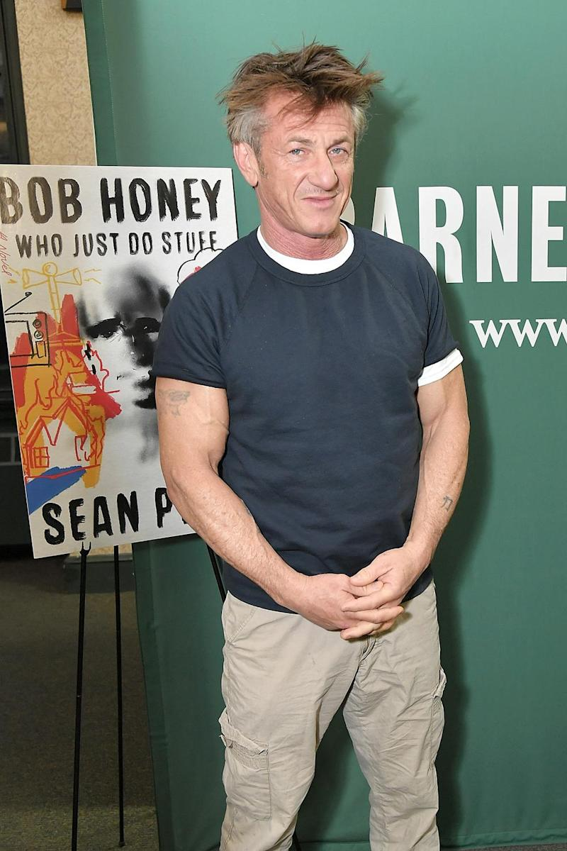 Panned: Sean Penn posing with the cover of his debut novel (Michael Loccisano/Getty)