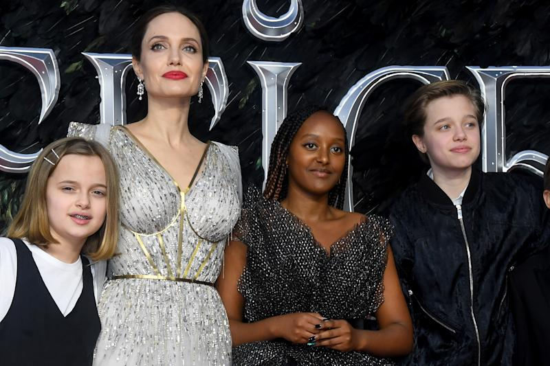 "LONDON, ENGLAND - OCTOBER 09: Angelina Jolie with children Vivienne Marcheline Jolie-Pitt, Zahara Marley Jolie-Pitt and Shiloh Nouvel Jolie-Pitt attend the European premiere of ""Maleficent: Mistress of Evil"" at Odeon IMAX Waterloo on October 09, 2019 in London, England. (Photo by Dave J Hogan/Getty Images)"