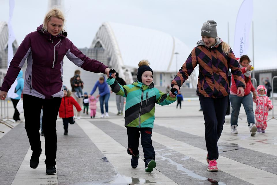 SOCHI, RUSSIA - MARCH 1, 2020: A family compete in the Pancake Run, the second event of Sirius Cup, at the Medals Plaza in Sochi Olymjpic Park on the final day of the Maslenitsa folk holiday. Pancakes are traditionally made and eated during Maslenitsa. Sirius Cup is a serius of races for professional athletes, amateurs, and children. Dmitry Feoktistov/TASS (Photo by Dmitry Feoktistov\TASS via Getty Images)