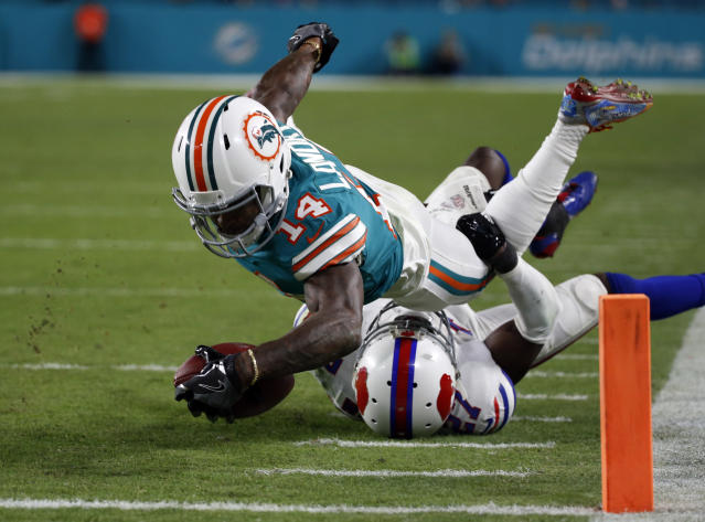 <p>Buffalo Bills cornerback Tre'Davious White (27) tackles Miami Dolphins wide receiver Jarvis Landry (14), during the second half of an NFL football game, Sunday, Dec. 31, 2017, in Miami Gardens, Fla. (AP Photo/Wilfredo Lee) </p>