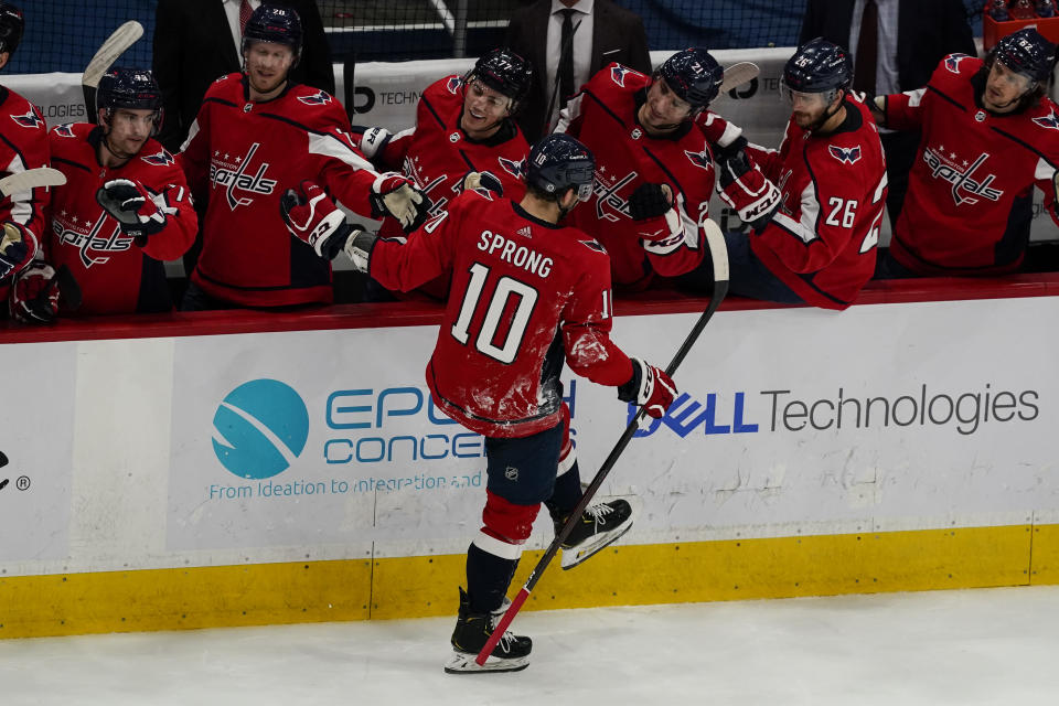 Washington Capitals right wing Daniel Sprong (10) celebrates his goal during the first period of an NHL hockey game against the Philadelphia Flyers, Friday, May 7, 2021, in Washington. (AP Photo/Alex Brandon)