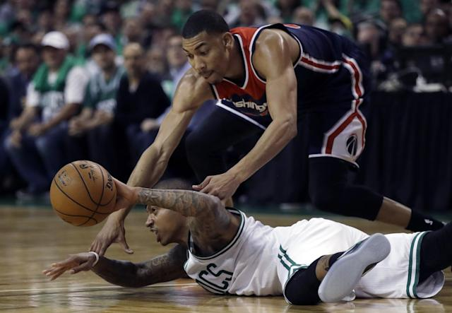 <p>Boston Celtics guard Isaiah Thomas makes a pass while sprawled on the floor as Washington Wizards forward Otto Porter Jr., top, defends during the second quarter of Game 7 of a second-round NBA basketball playoff series, Monday, May 15, 2017, in Boston. (AP Photo/Charles Krupa) </p>