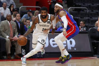 Brooklyn Nets guard Kyrie Irving (11) drives against Detroit Pistons guard Bruce Brown (6) in the first half of an NBA basketball game in Detroit, Saturday, Jan. 25, 2020. (AP Photo/Paul Sancya)