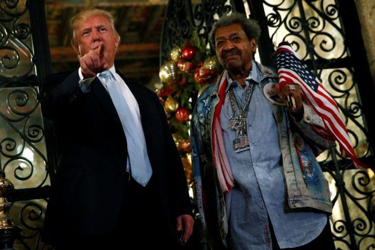 President-elect Donald Trump and boxing promoter Don King speak to reporters outside the Mar-a-lago Club in Palm Beach, Fla. (Photo: Jonathan Ernst/Reuters)