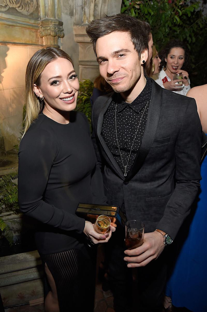 Hilary Duff (Left) and Matthew Koma (Right) pose holding drinks and smiling