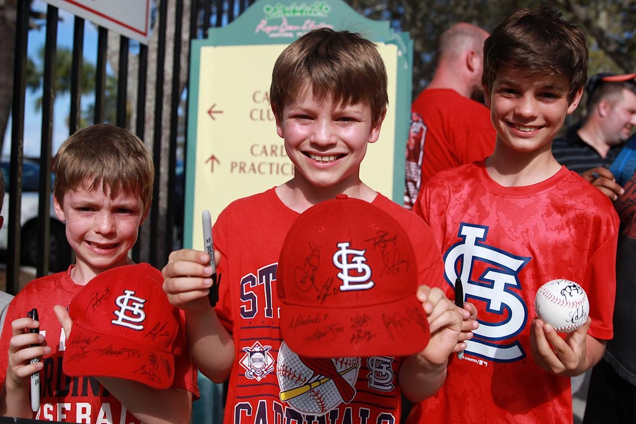 <p>A group of young St. Louis Cardinals fans hold up autographs while standing outside the players gate after the spring training baseball game against the New York Mets at Roger Dean Stadium in Jupiter, Fla., Wednesday, March 1, 2017. (Gordon Donovan/Yahoo Sports) </p>