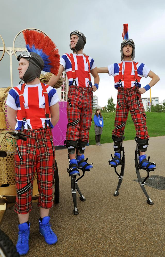 LONDON, UNITED KINGDOM - JULY 20: The sight that greets arriving Athletes at their Olympic Village, where members of the National Youth Theatre of Britain welcome them with song and dance routines, on July 20, 2012 in London, England. The opening ceremony of the games will take place in seven days. (Photo by John Stillwell - WPA Pool /Getty Images)