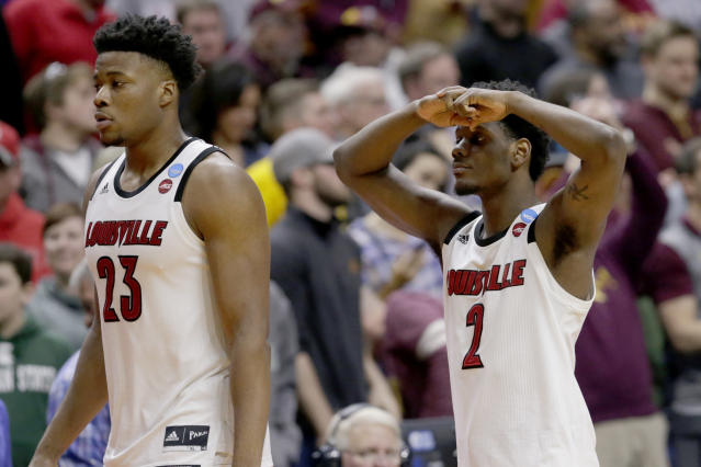 <p>Louisville's Darius Perry (2) and Steven Enoch (23) walk off the court following their 86-76 loss to Minnesota in a first round men's college basketball game in the NCAA Tournament, in Des Moines, Iowa, Thursday, March 21, 2019. (Nati Harnik/AP) </p>