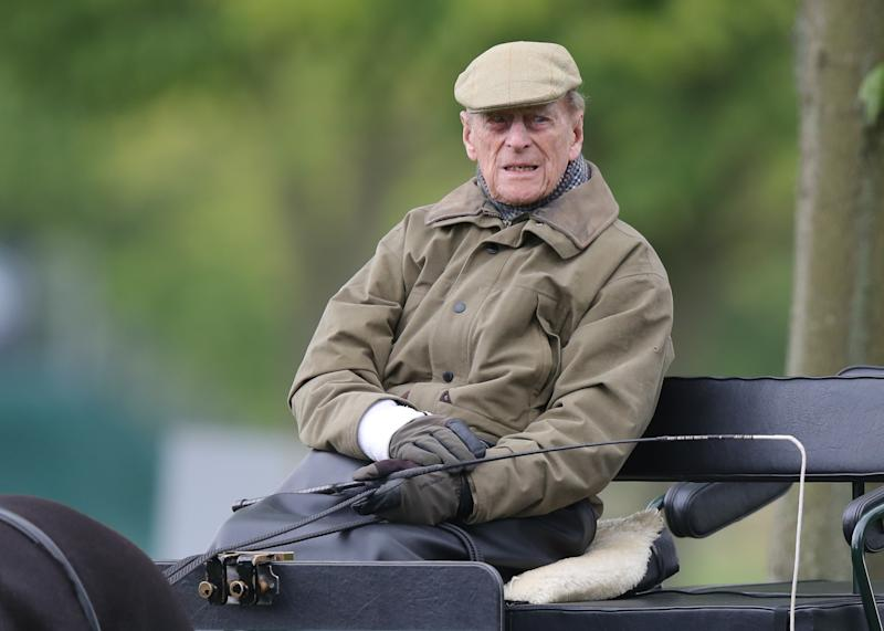 The Duke of Edinburgh drives a carriage during the Royal Windsor Horse Show in Windsor, Berkshire.