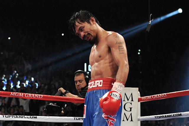 LAS VEGAS, NV - NOVEMBER 12: Manny Pacquiao reacts after the 12th round before it is announced that he won by majority decision against Juan Manuel Marquez in the WBO world welterweight title fight at the MGM Grand Garden Arena on November 12, 2011 in Las Vegas, Nevada. (Photo by Harry How/Getty Images)