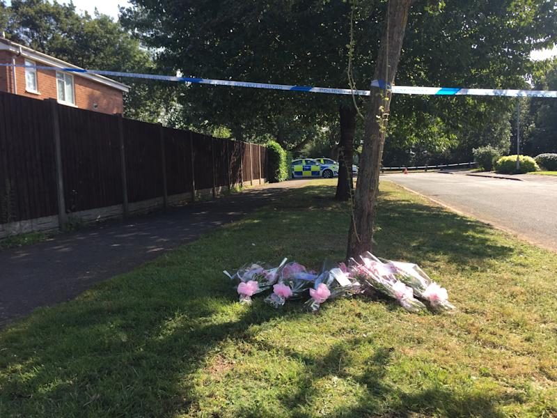 Floral tributes left at the scene in Wigginton Park, Tamworth, Staffordshire, where a 19-year-old woman died on Thursday evening.