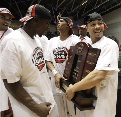 Mississippi Valley State's William Pugh, left, Terrence Joyner, center, and Kevin Burwell, right, celebrate with the championship trophy following their NCAA college basketball game against Texas Southern in the Southwestern Athletic Conference tournament, Saturday, March 10, 2012, in Garland, Texas. Mississippi Valley State won 71-69. (AP Photo/Tony Gutierrez)