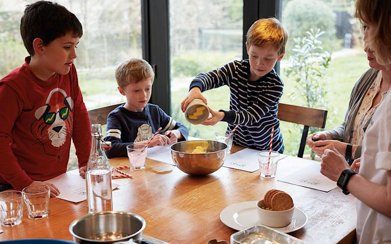boys taking part in the Gluts & gluttony cooking class - Credit: Kitty Gale