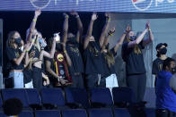 Players from the Stanford national championship women's basketball team wave while acknowledged during the first half of an NBA basketball game between the Golden State Warriors and the Utah Jazz in San Francisco, Monday, May 10, 2021. (AP Photo/Jeff Chiu)