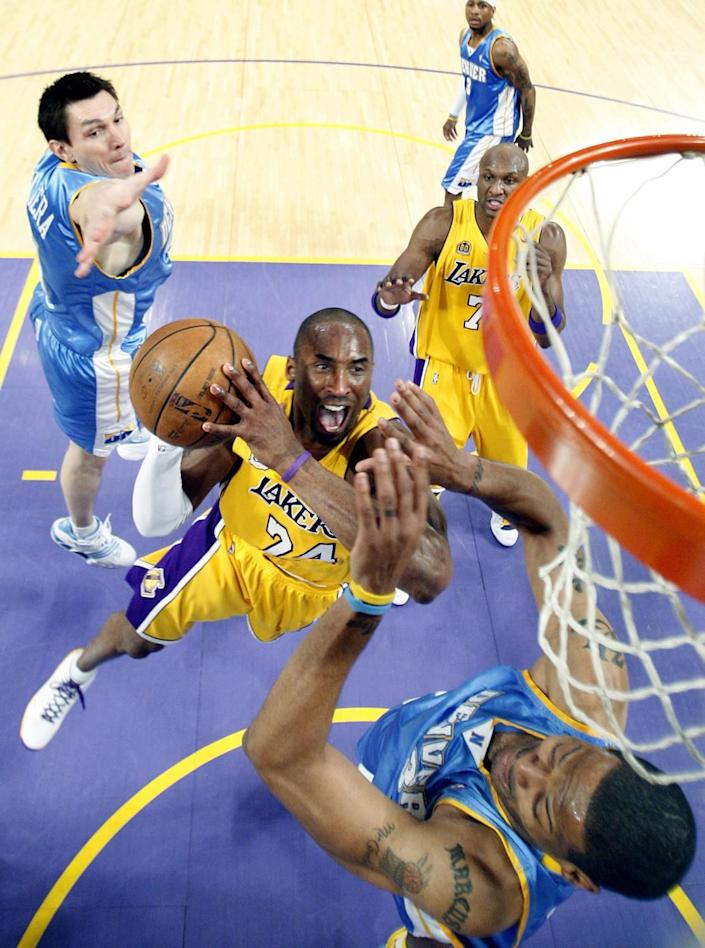 Kobe Bryant drives to the basket against the Nuggets.