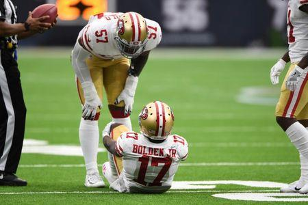 Dec 10, 2017; Houston, TX, USA; San Francisco 49ers wide receiver Victor Bolden (17) sits on the field as outside linebacker Eli Harold (57) looks on during the second quarter against the Houston Texans at NRG Stadium. Mandatory Credit: Shanna Lockwood-USA TODAY Sports