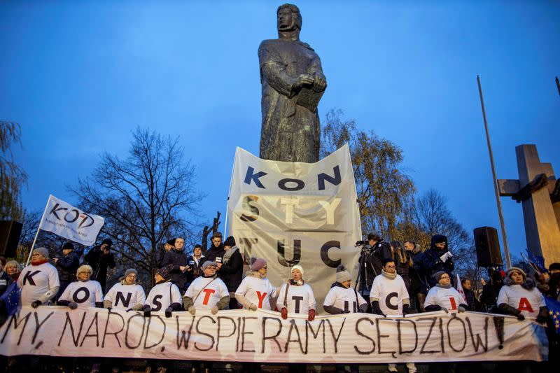 People take part in an anti-government protest in support of free judiciary in Poznan