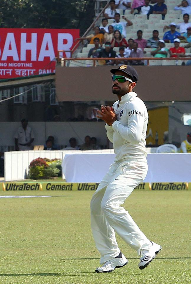 Virat Kholi of India takes the catch to dismiss Chris Gayle of West Indies  during day three of the first Star Sports test match between India and The West Indies held at The Eden Gardens Stadium in Kolkata, India on the 8th November 2013  Photo by: Ron Gaunt - BCCI - SPORTZPICS