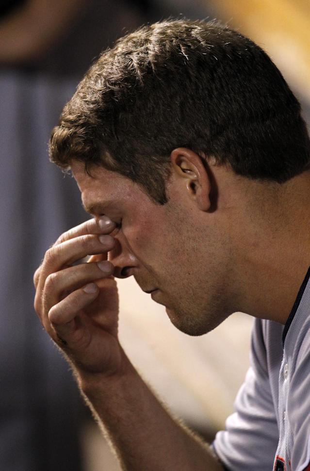 Cleveland Indians pitcher Nick Hagadone reacts after being taken out in the eighth inning of a baseball game against the Kansas City Royals at Kauffman Stadium in Kansas City, Mo., Tuesday, June 10, 2014. (AP Photo/Colin E. Braley)