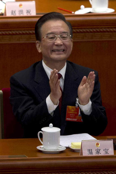 Outgoing Chinese Premier Wen Jiabao applauds during the opening session of the annual National People's Congress in Beijing's Great Hall of the People, China, Tuesday, March 5, 2013. China's government promised its people Tuesday deficit-fueled spending to fight deep-seated corruption, improve the despoiled environment and address other quality-of-life issues demanded by an increasingly vocal public looking for change. (AP Photo/Ng Han Guan)