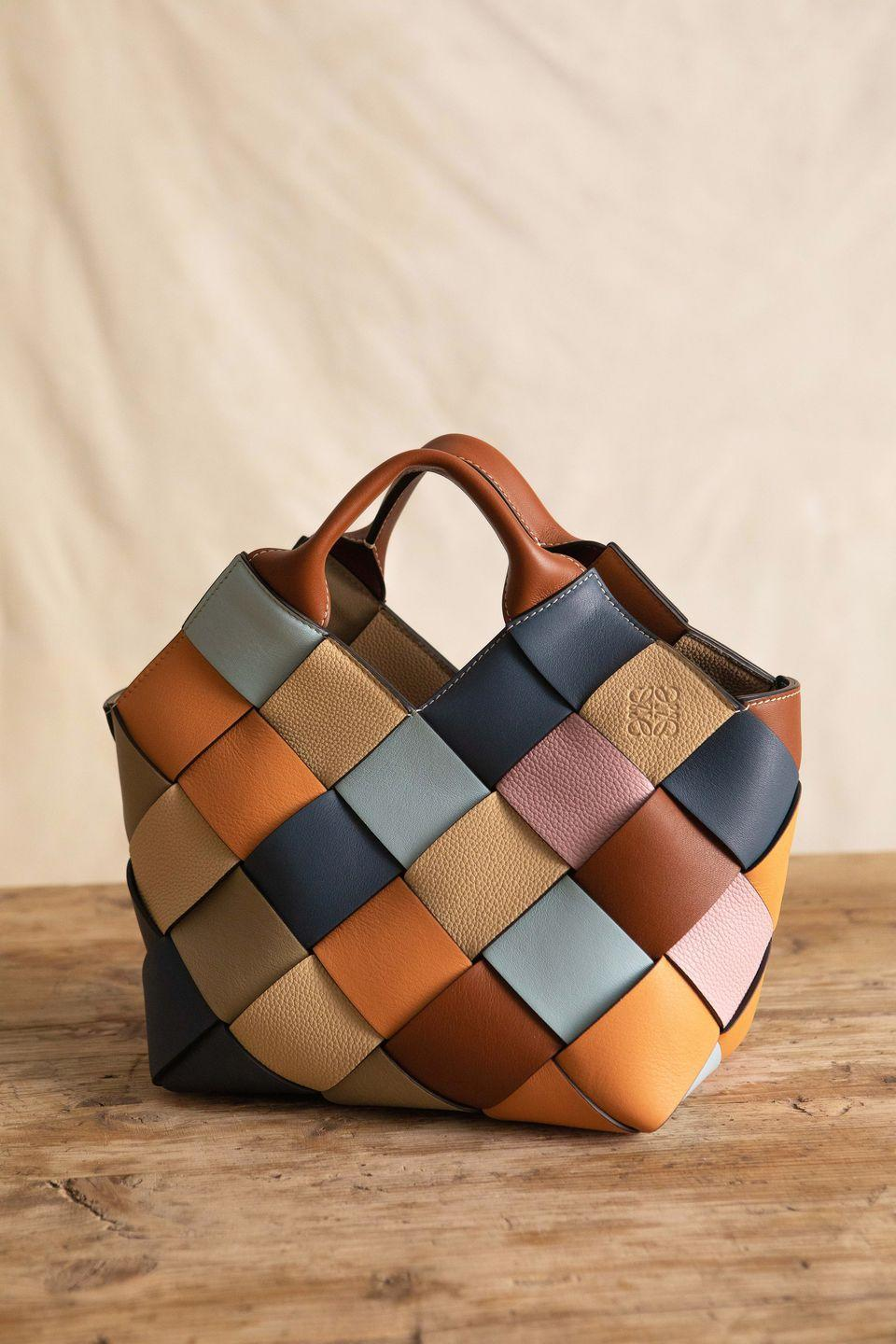 """<p><strong>Who: </strong>Loewe</p><p><strong>What: </strong>Surplus Woven tote and Crab Charms</p><p><strong>Where:</strong> Online at LOEWE.com</p><p><strong>Why: </strong>It's no secret that Loewe handbags are some of the most luxurious and well-crafted leather goods in the business. Jonathan Anderson's craftsman touch can be seen in the Surplus Woven tote bags, made from scraps of grained and smooth leather from previous seasons, tightening the production circle and maximizing the use of raw materials. The result is a timelessly gorgeous piece of art that's practical and durable.</p><p><a class=""""link rapid-noclick-resp"""" href=""""https://www.loewe.com/usa/en/home"""" rel=""""nofollow noopener"""" target=""""_blank"""" data-ylk=""""slk:SHOP NOW"""">SHOP NOW</a><br><strong><br></strong></p>"""