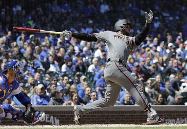 Arizona Diamondbacks' David Peralta hits a solo home run against the Chicago Cubs during the first inning of a baseball game Saturday, April 20, 2019, in Chicago. (AP Photo/Nam Y. Huh)