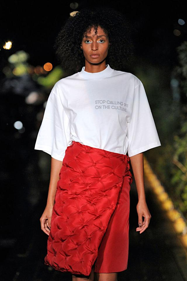 "<p>During Pyer Moss's SS19 show, designer Kerby Jean-Raymond made a powerful political statement by presenting a T-shirt that read, ""Stop calling 911 on the culture."" This is a reference to the several cases within the past year when police were called on black men and women. Two notable examples took place in April, when a white woman <a rel=""nofollow"" href=""https://www.huffingtonpost.com/entry/woman-calls-police-oakland-barbecue_us_5af50125e4b00d7e4c18f741"">called the police on a black family having a barbecue</a> in Oakland, Calif., and when two black men were waiting for a friend at <a rel=""nofollow"" href=""https://www.yahoo.com/news/starbucks-ceo-apologizes-reprehensible-arrest-two-black-men-171245155.html"">Starbucks and an employee called 911</a>. (Photo: Getty) </p>"